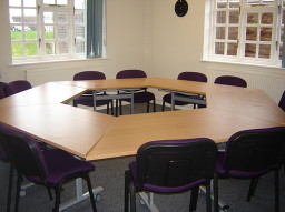 View of the lounge for hire with hexagonal table layout